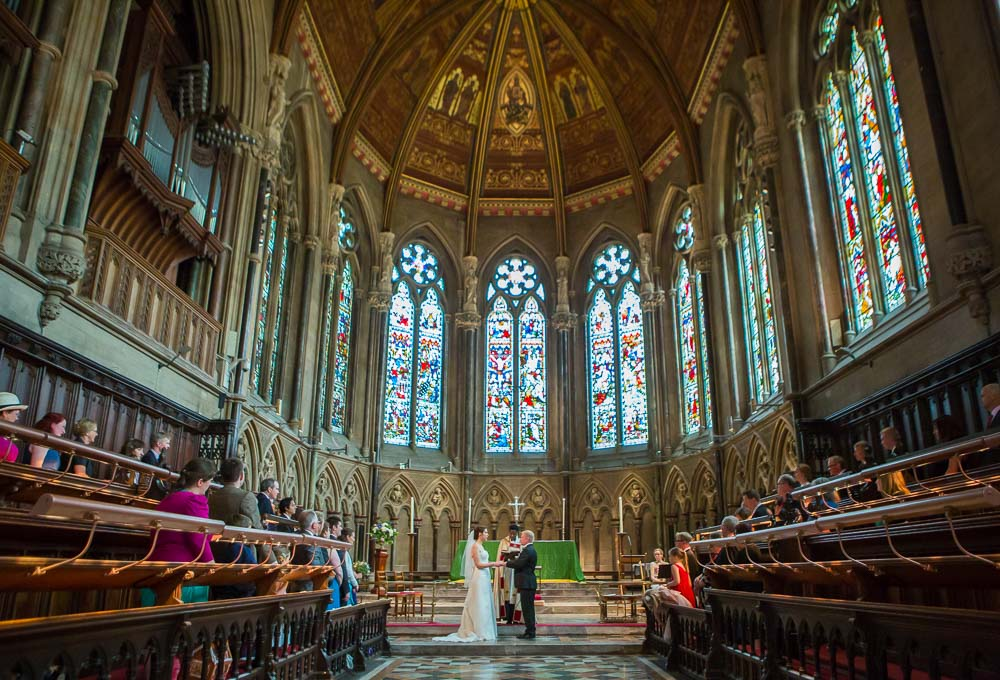 Bride and groom reading their vows at St John's College Wedding