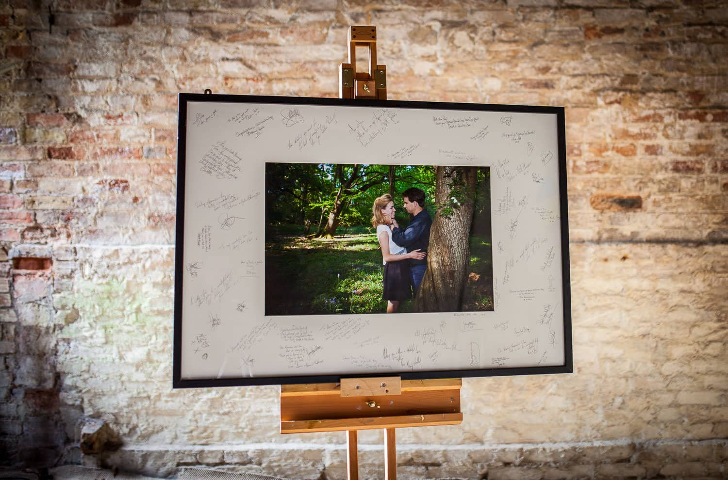 One of our signing mounts sitting on an easel, in our wedding photography studio ready to be delivered to a client.