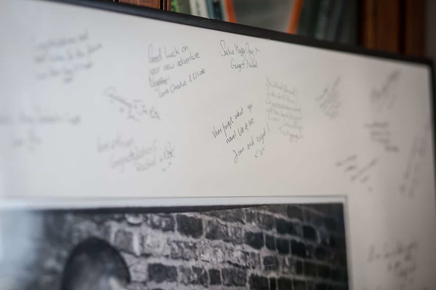 Close up of signatures on one of our signing mounts