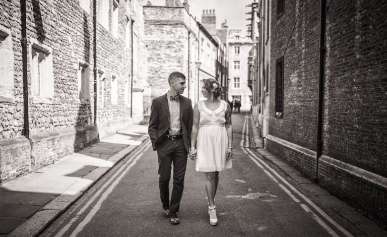 Couple walking in Cambridge during their engagement shoot