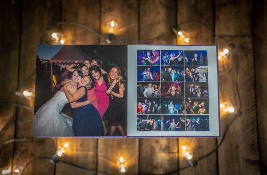 Wedding album open and displayed in industrial studio