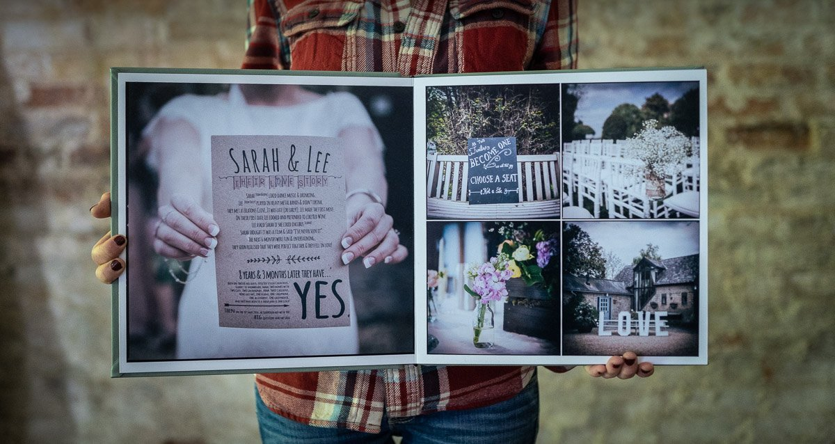 Wedding album open and being held