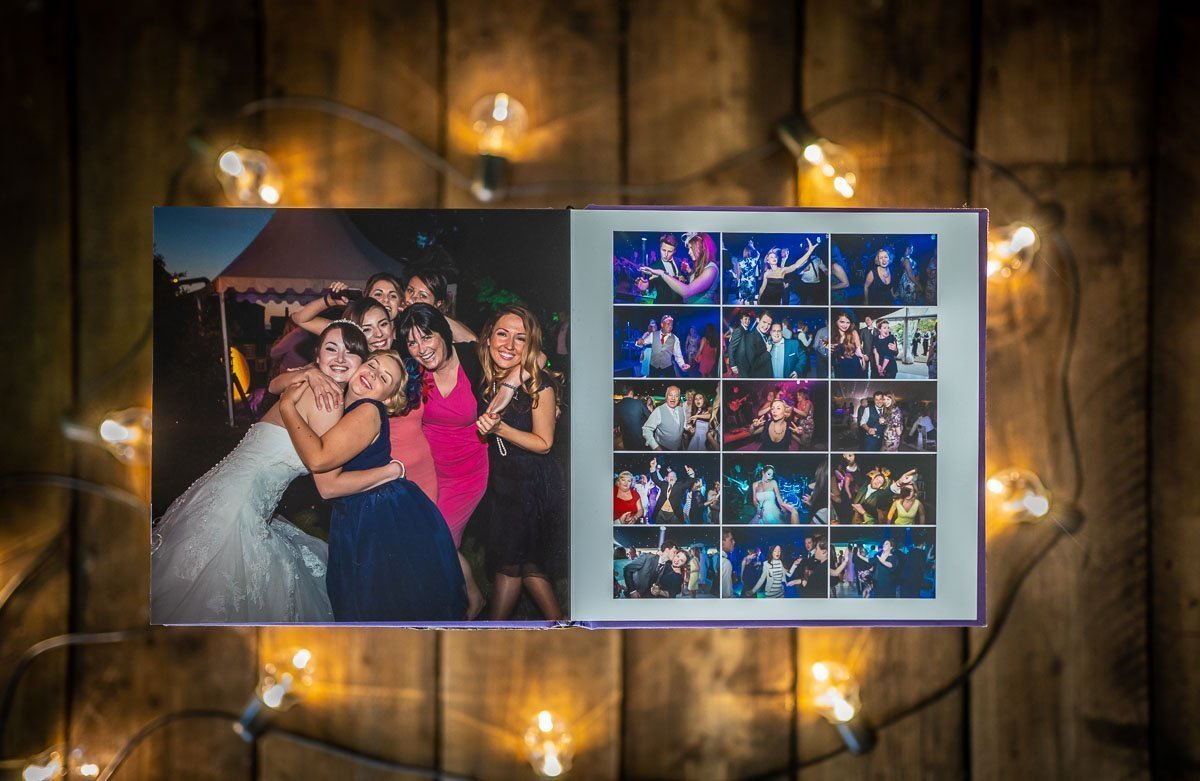 Wedding album displayed open against an industrial background with lights around