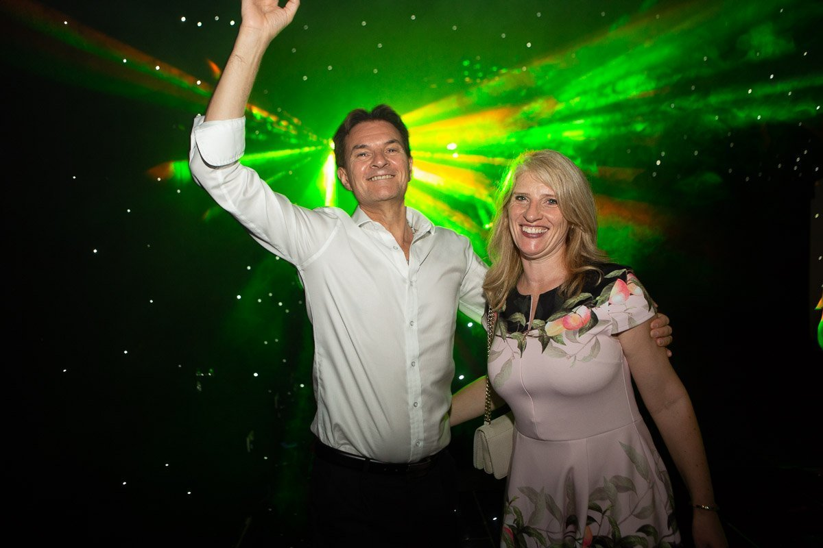 wedding guests dancing with lots of disco lights around them, cambridge wedding photographer