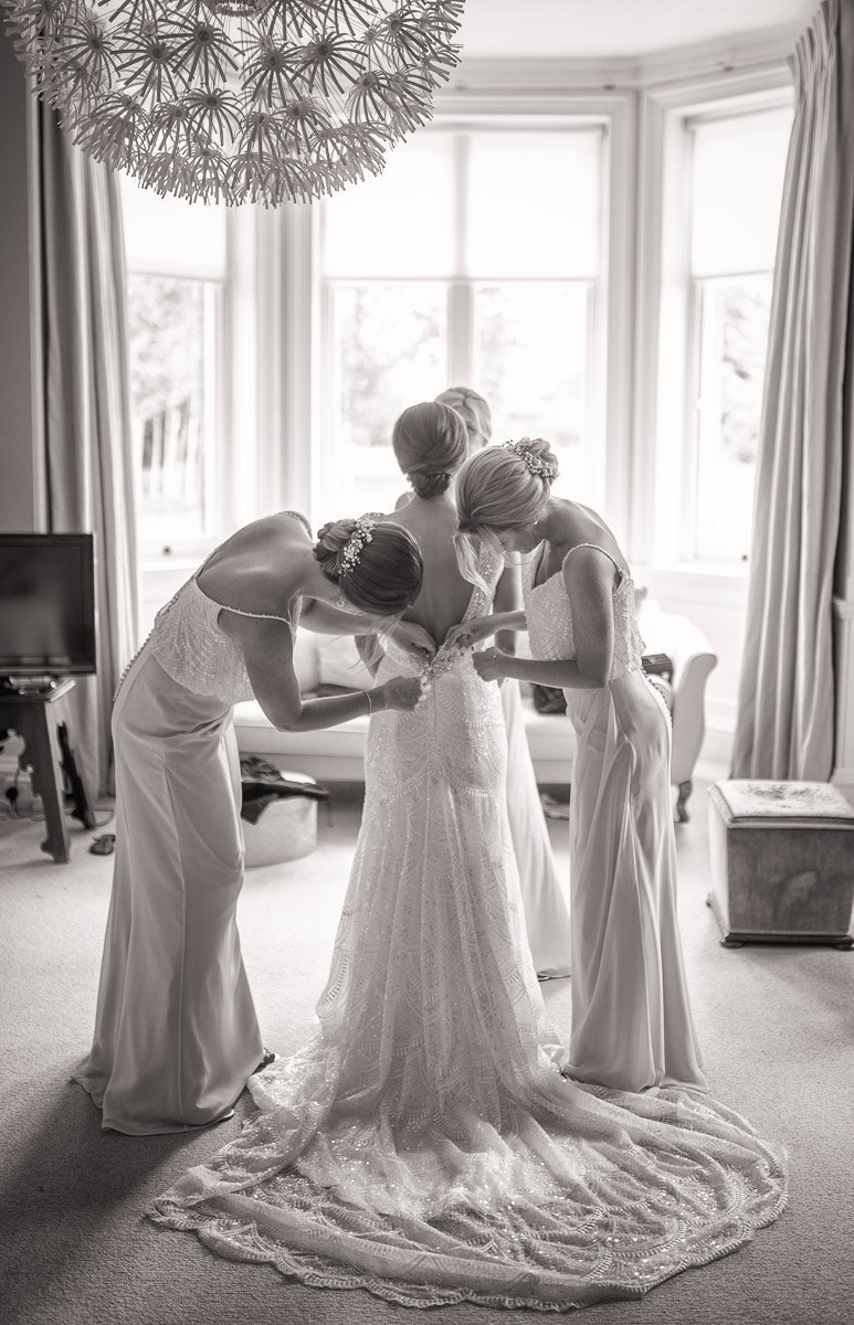 Bride getting dressed at Chippenham Wedding