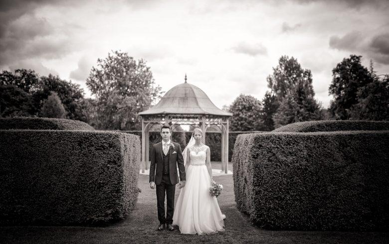 Bride and Groom standing in grounds of Chippenham Wedding