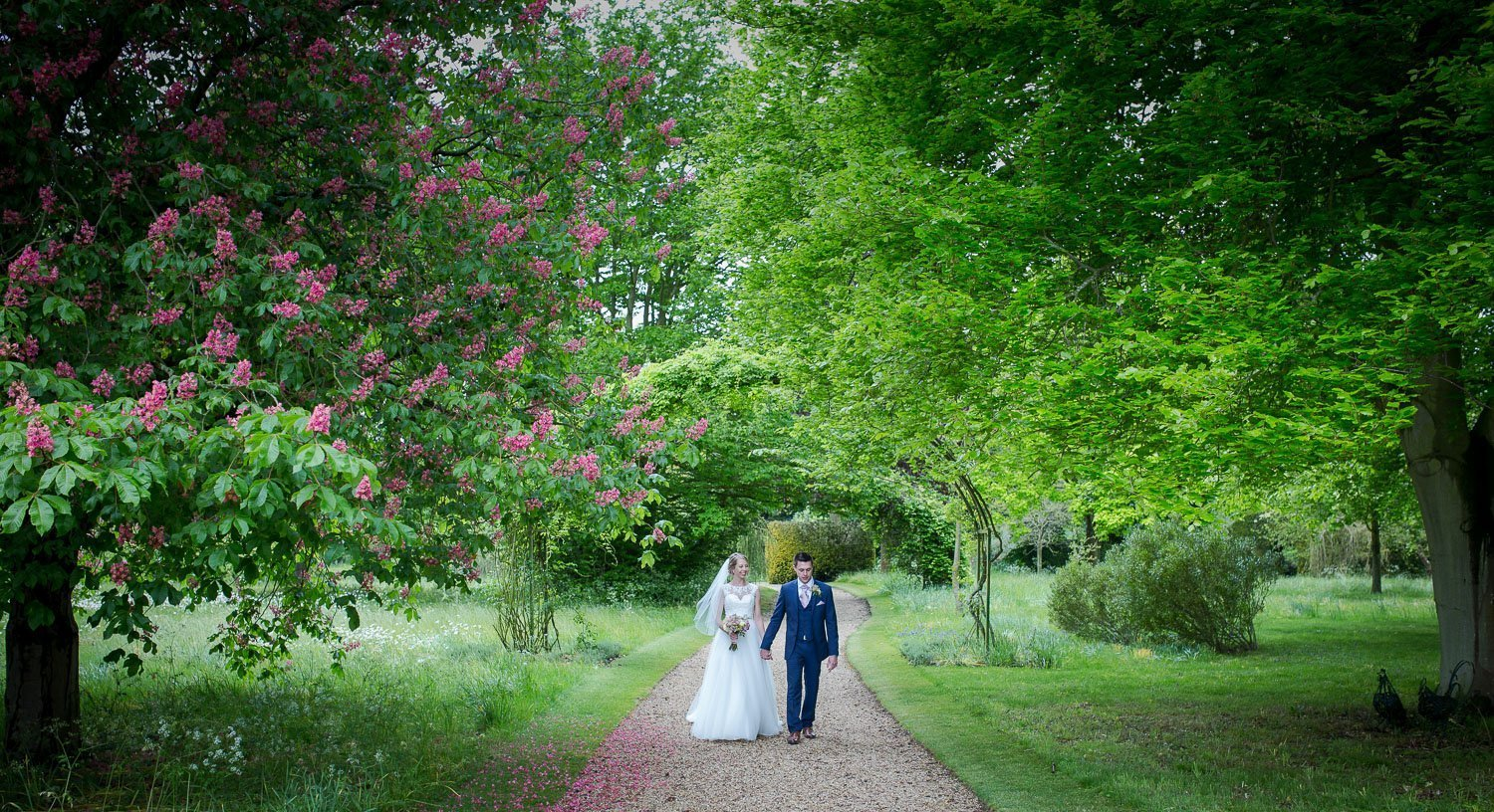 Brie and groom walking along Chippenham Wedding