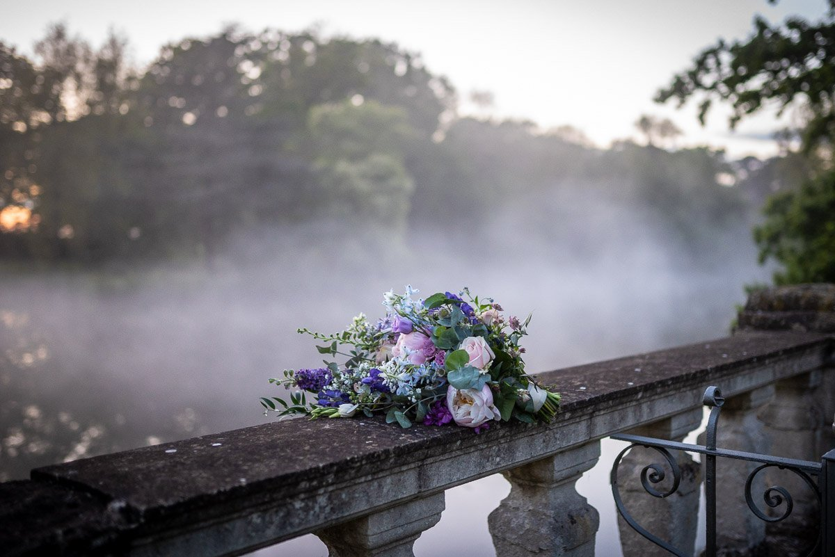 Bridal bouquet on bridge at Longstowe Hall