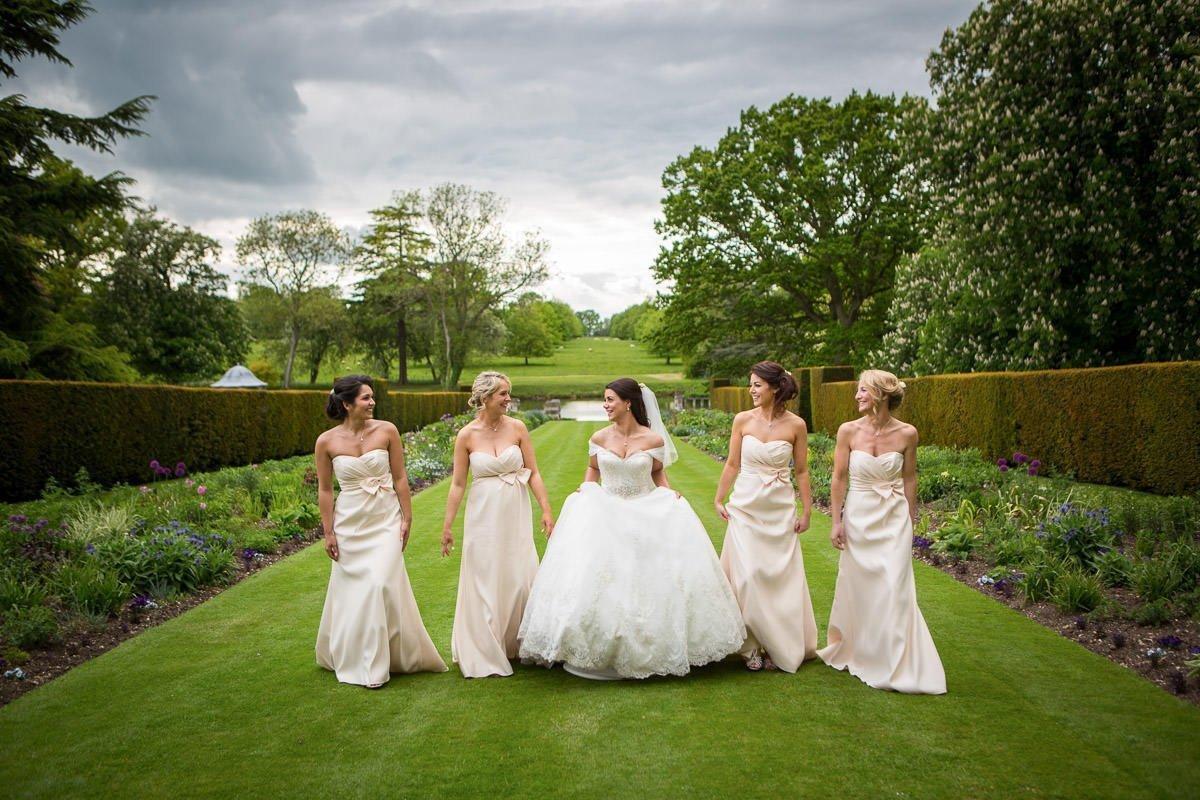 Bridal party walking in Longstowe Hall