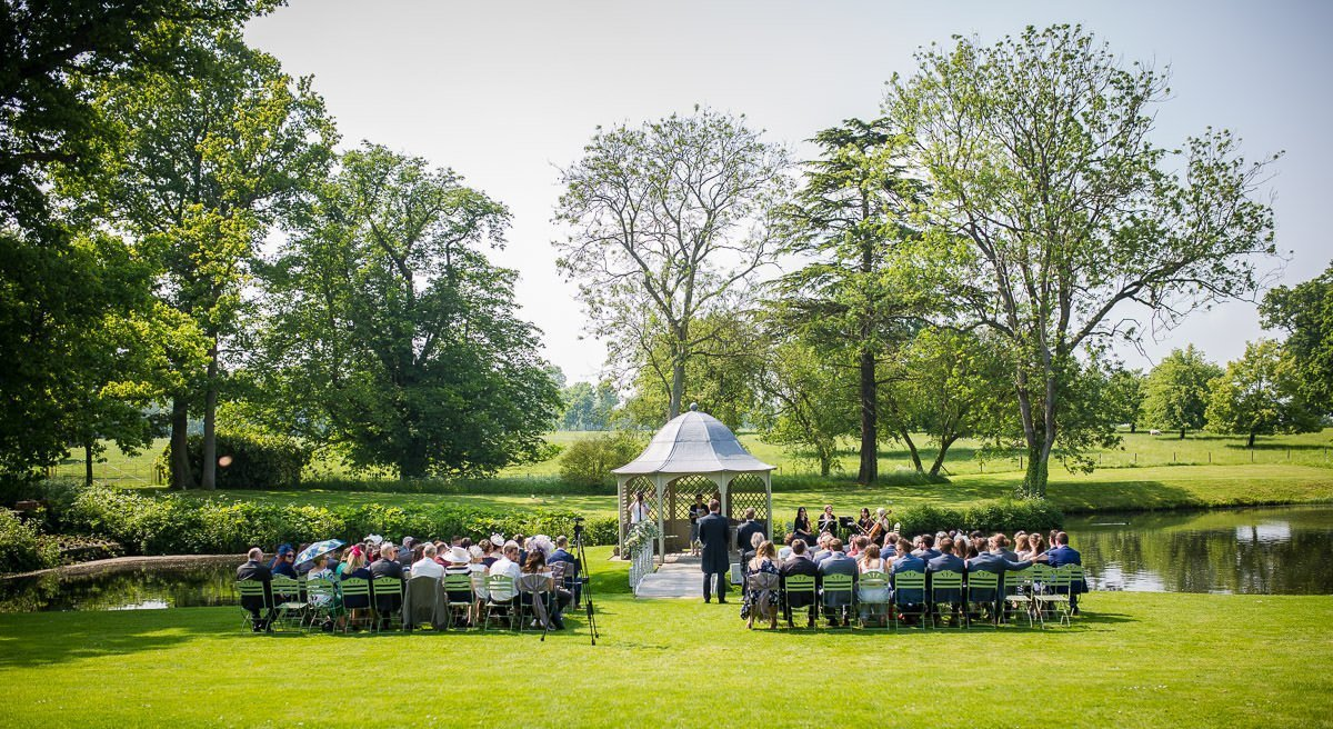 Longstowe Hall outside ceremony area with guests