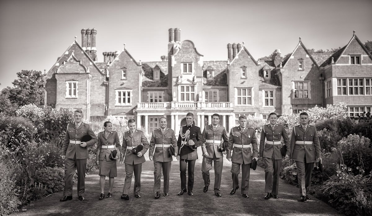 black and white image of Groom's party walking in Longstowe Hall