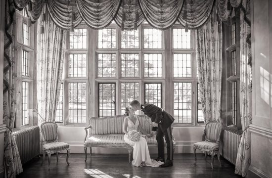Bride and Groom sitting in main ball room at Longstowe Hall Wedding, Cambridge, black and white wedding photographs collection.