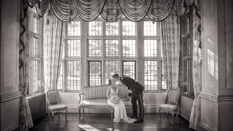 Bride and Groom sitting in main ball room at Longstowe Hall Wedding, Cambridge