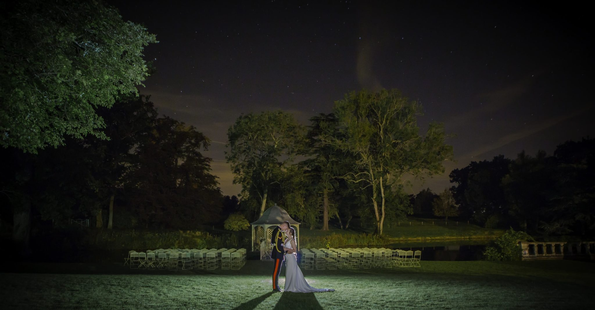 Bride and groom photographed at night at Longstowe Hall