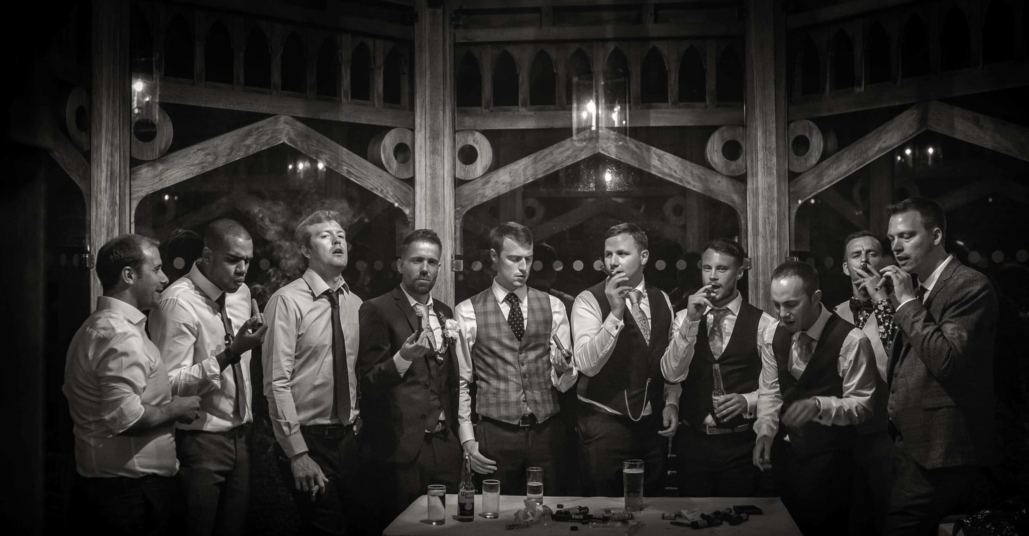 Group of grooms' men smoking cigars at The Old Hall, Ely, Wedding