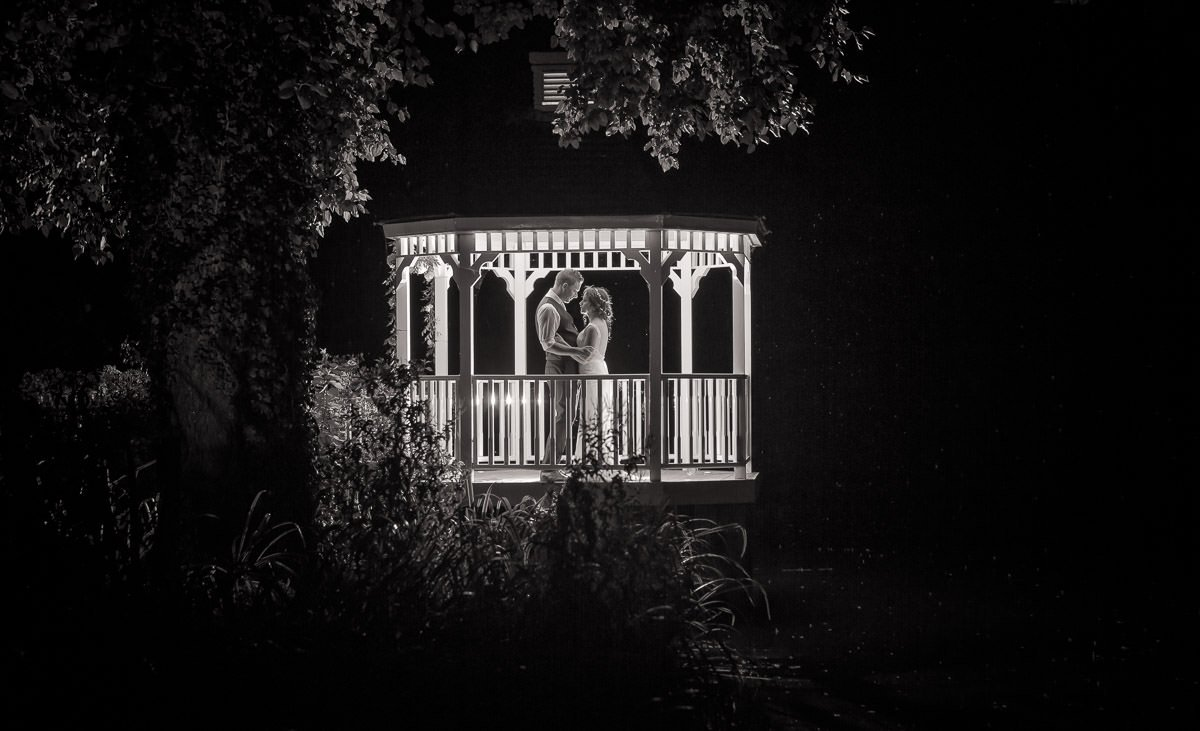Black and White wedding photographs collection of bride and groom on a veranda shot at night.