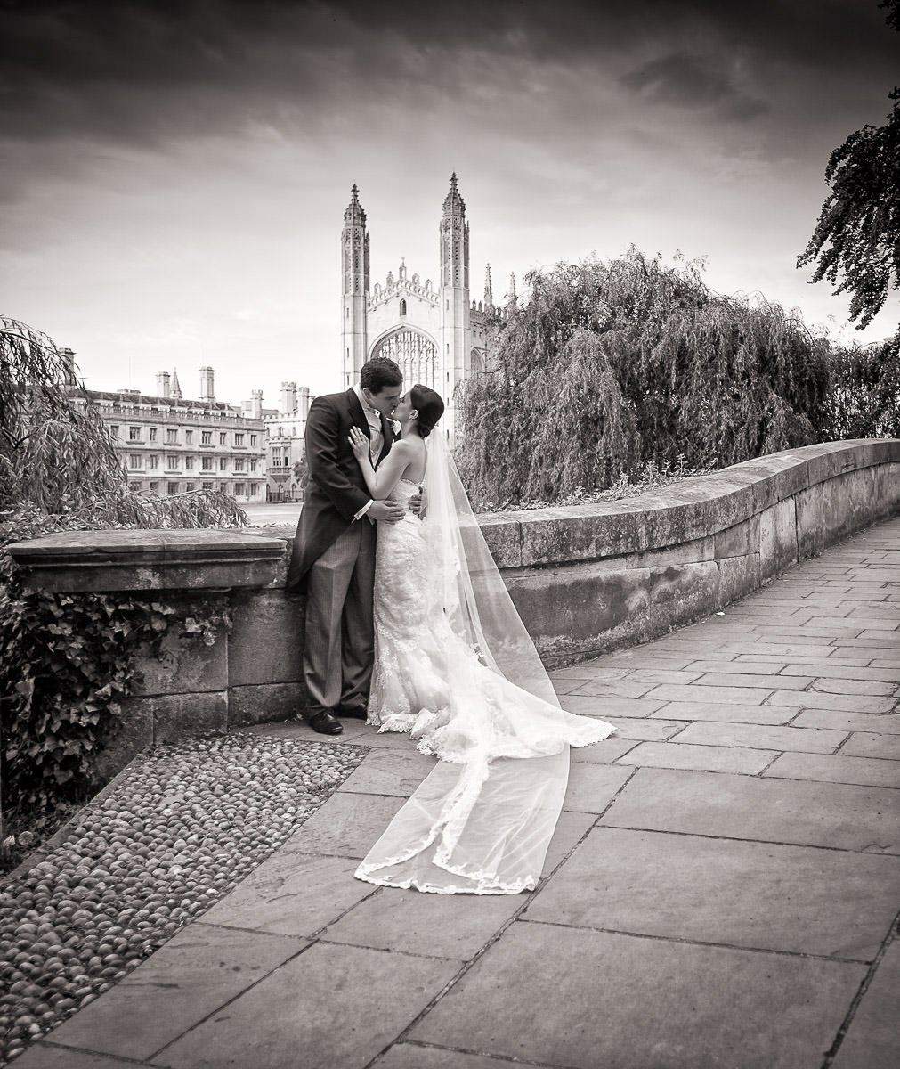 Bride and Groom kissing in front of Kings college by Cambridge Wedding Photographer
