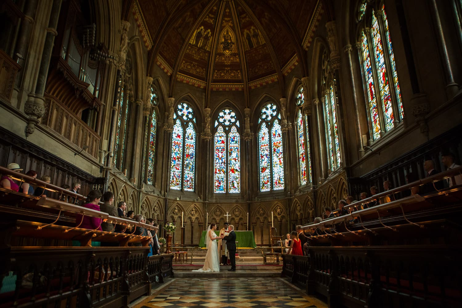 Bride and groom standing at St Johns Chapel, Cambridge