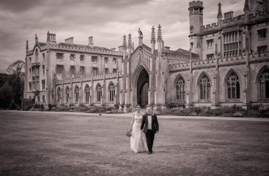 Bride and groom walking away from a St Johns College Wedding