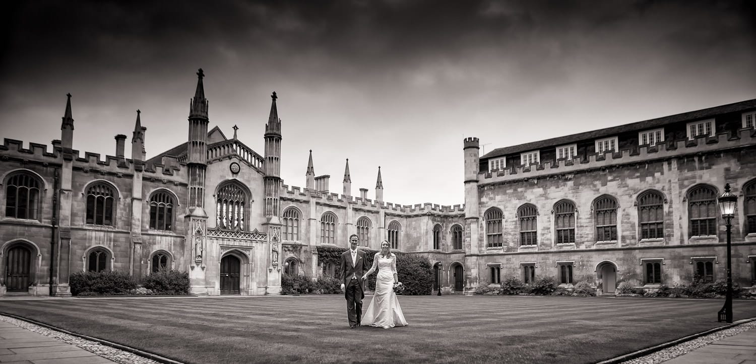 Bride and groom standing on the lawns at Corpus Christie college in Cambridge
