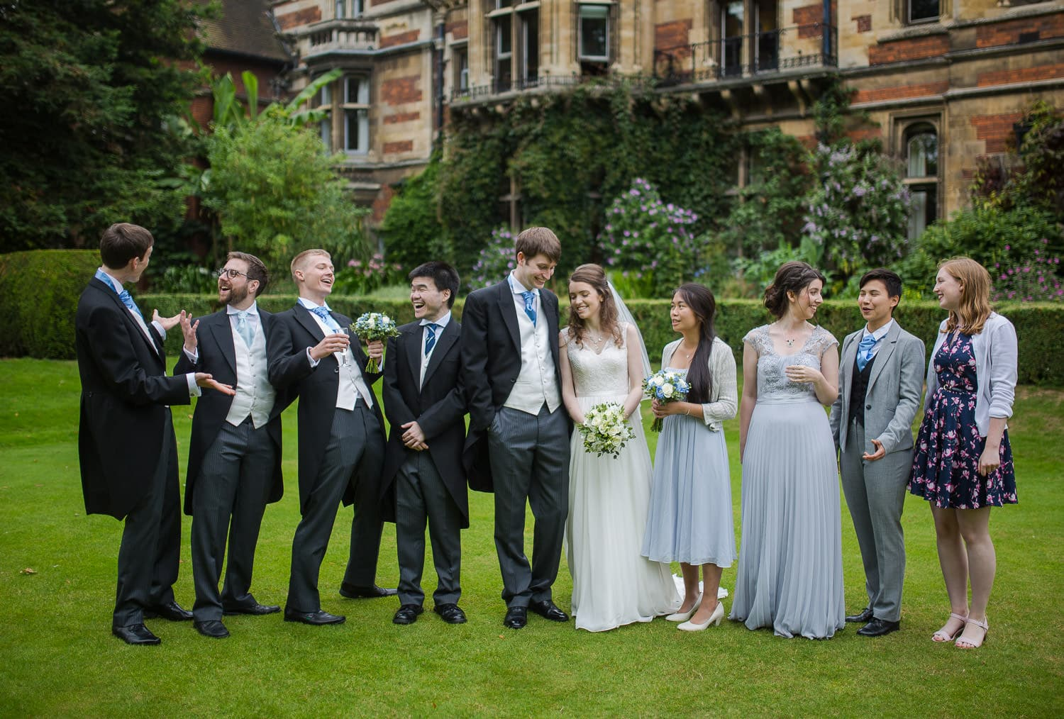 Relaxed group shot at college wedding