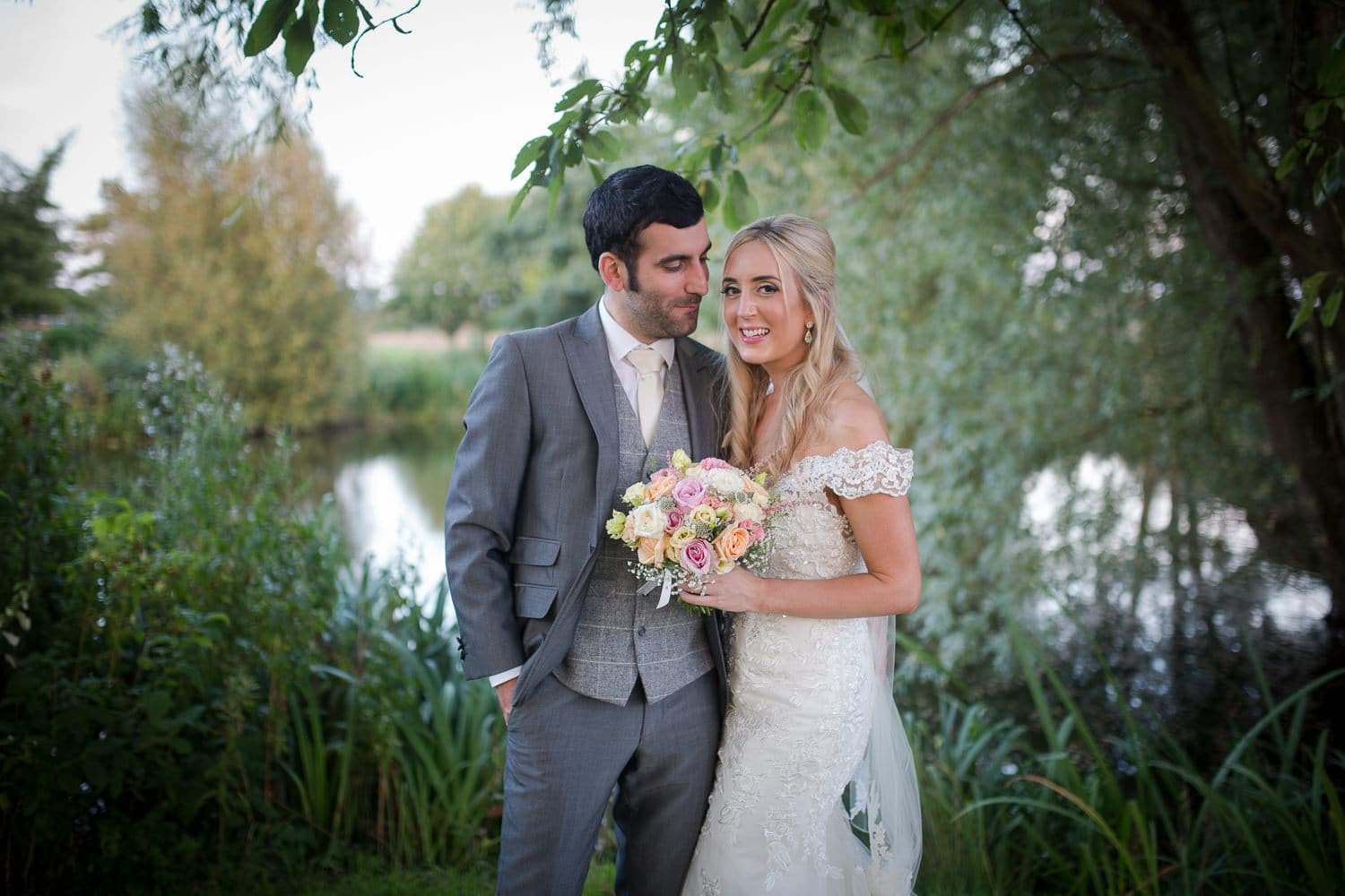 Bride and Groom standing together at Granary Barns Wedding