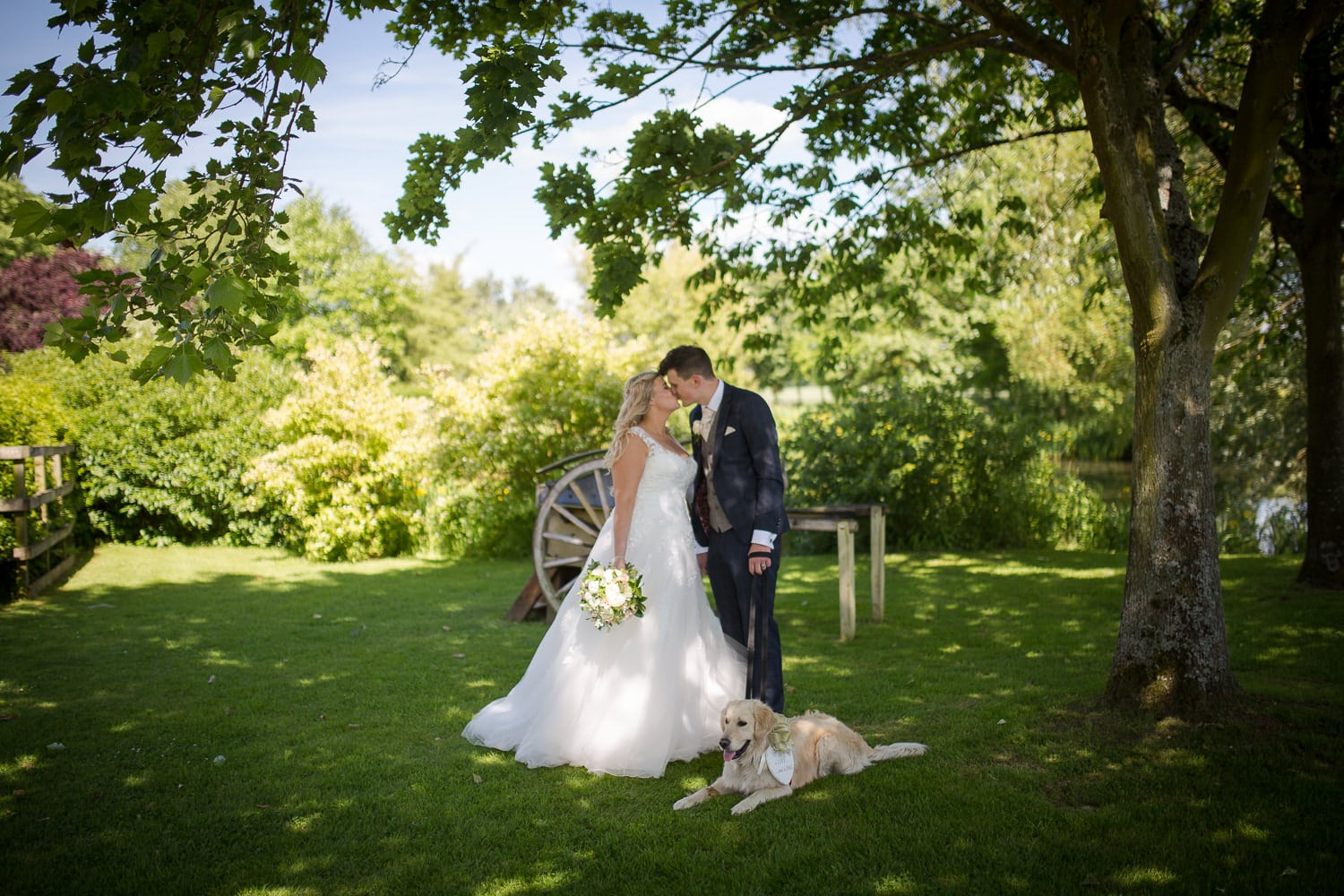 Bride and groom with their dog, at granary barns image used for wedding photography pricing.