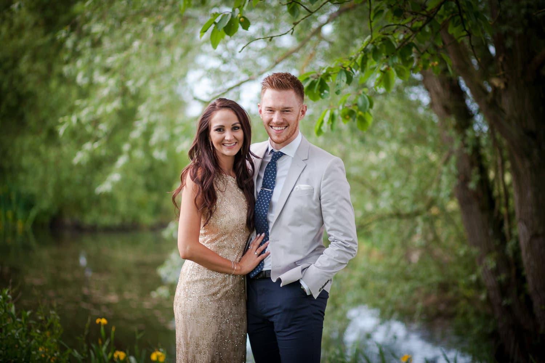 couple standing near lake at Granary Barns Wedding