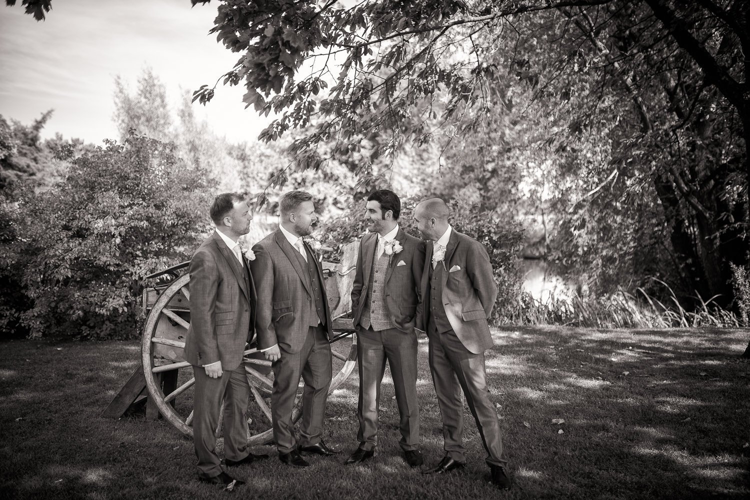 Groom and his party laughing together at Granary Barns Wedding, in black and white