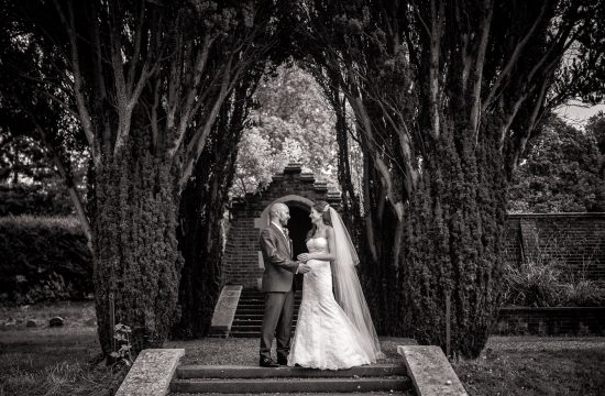 Black and White shot of bride and groom standing at Lanwades