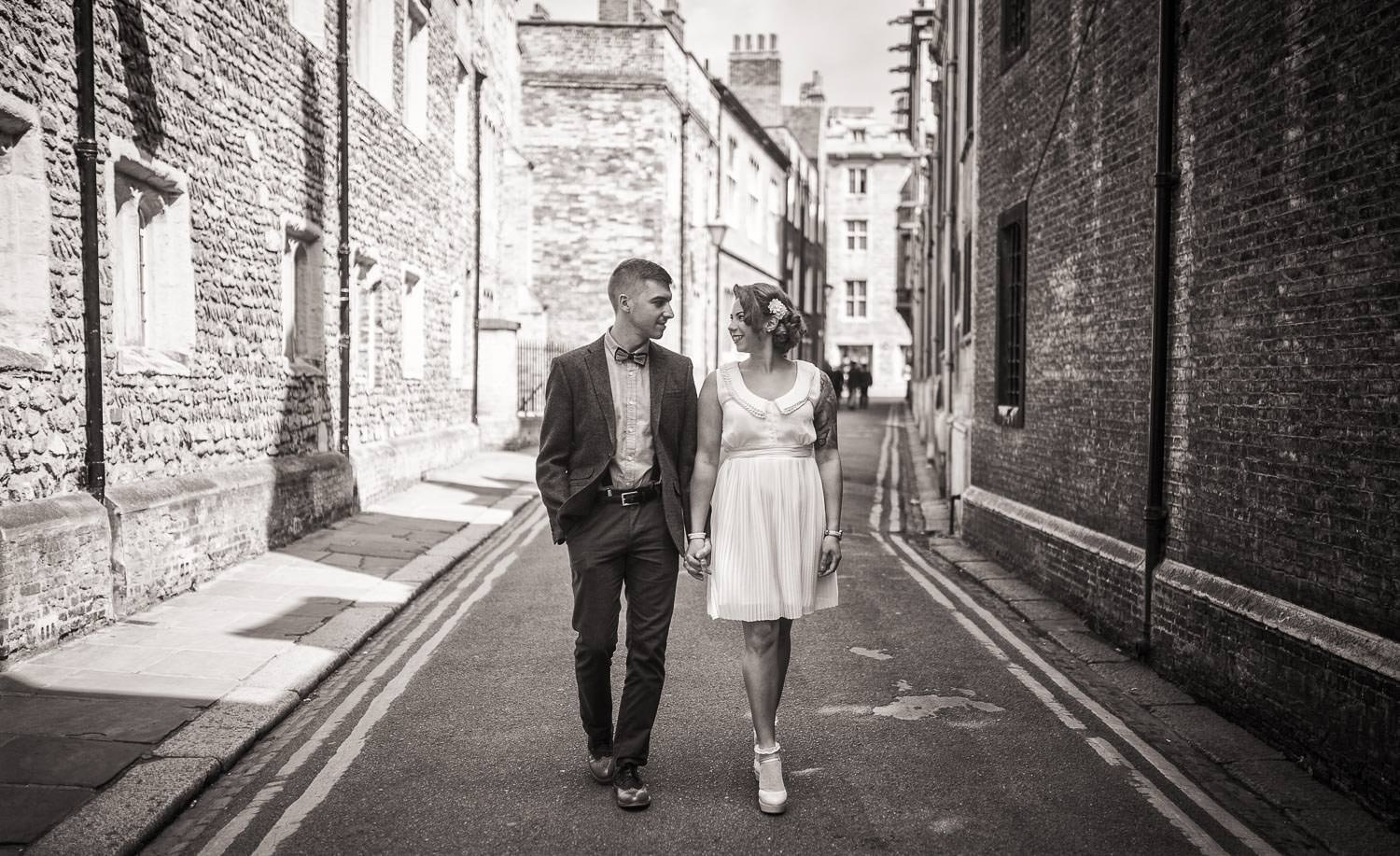 Couple walking along cobbled street .engagement shoots and pre-wedding shoots