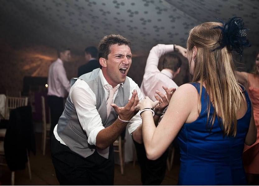 Wedding guest dancing at a party