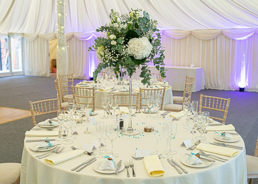 Table setting with flower centre piece at Longstowe Wedding