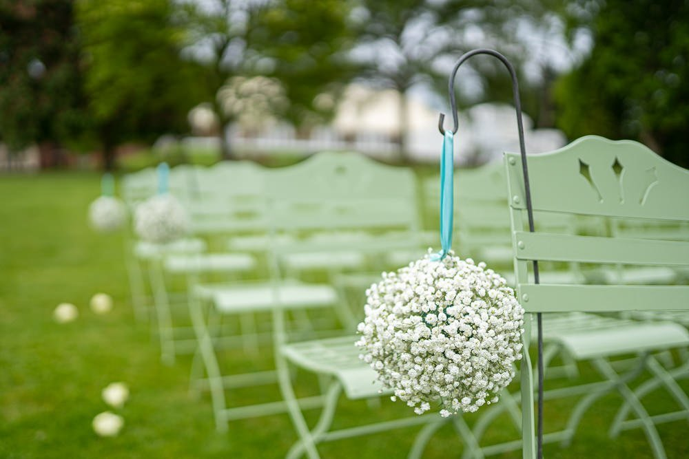 Cair decoration on ceremony chair at Longstowe Wedding