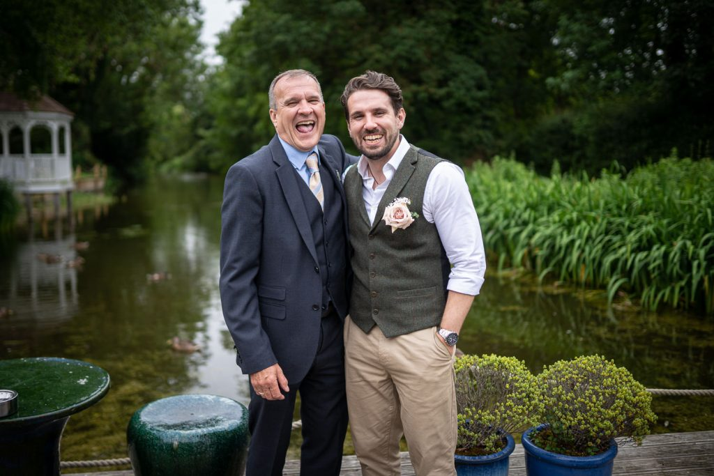 Groom and rathe rlaughing at Sheen Mill Wedding