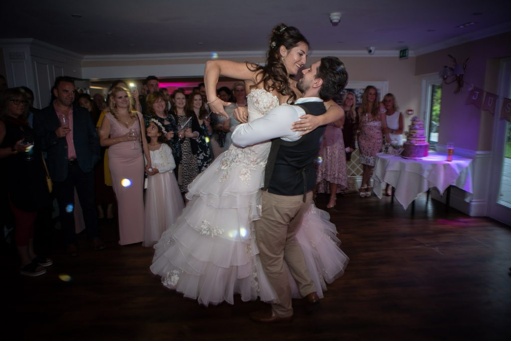 Groom spinning his bride during their first dance.