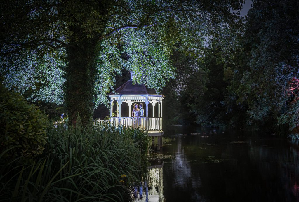 Night time shot of bride and groom in the pagoda at Sheen Mill photographed by JuanMuino.com