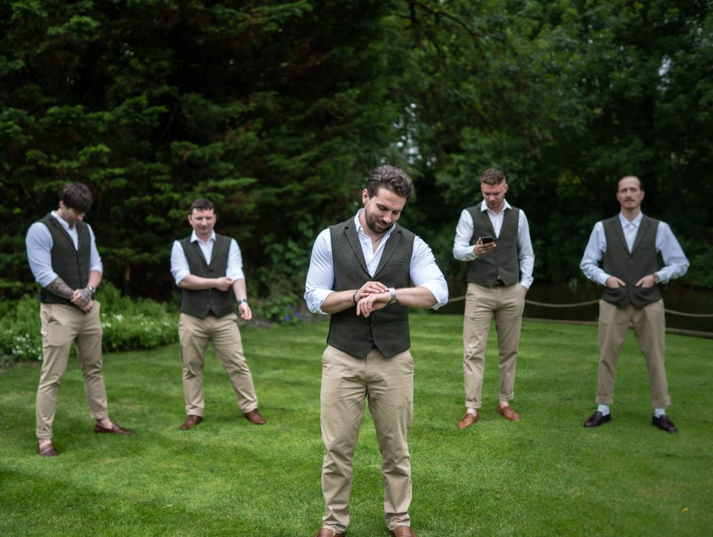 Groom and his groomsmen standing at their Sheen Mill Wedding
