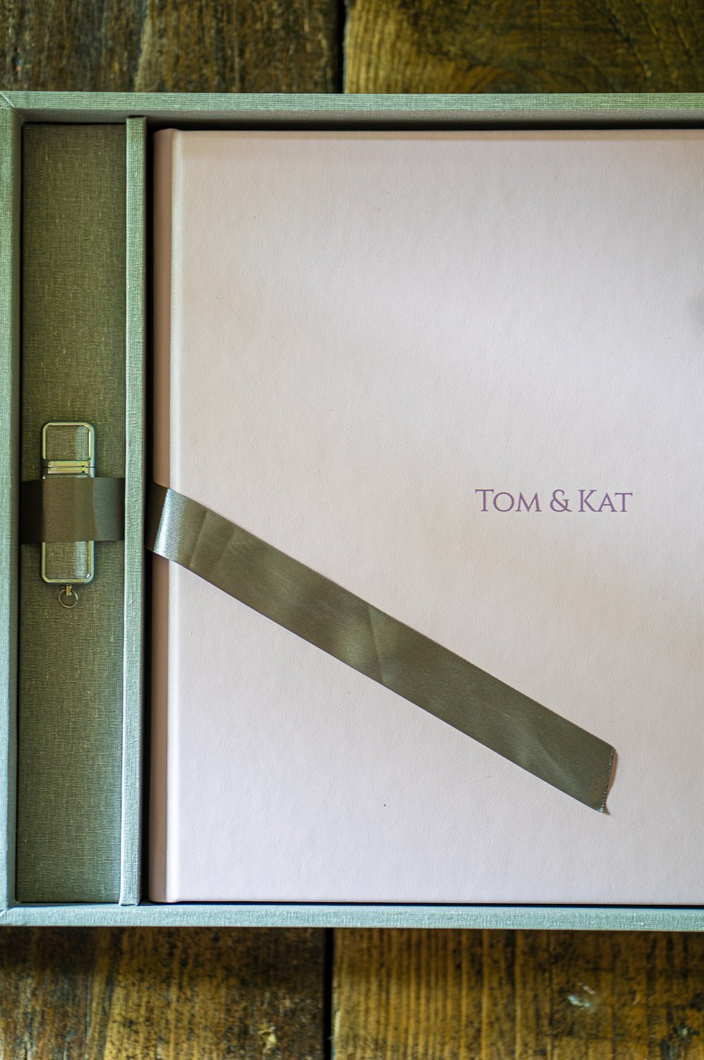 Gorgeous presentation box, opened showing an album in pink, with the inscription Tom & Kat