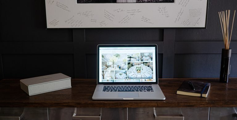 Here our laptop showing one of our stunning galleries in our wedding photography studio.