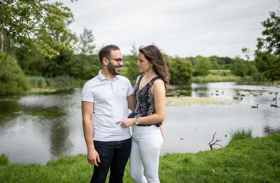 engagement shoot cambridge - couple by a lake