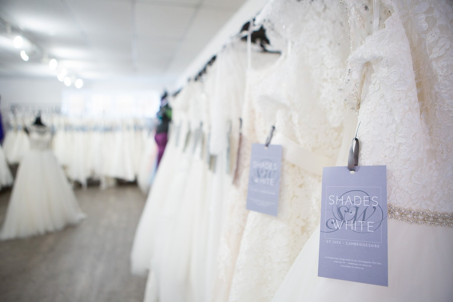 Wedding gowns in a wedding boutique, one of our wedding suppliers