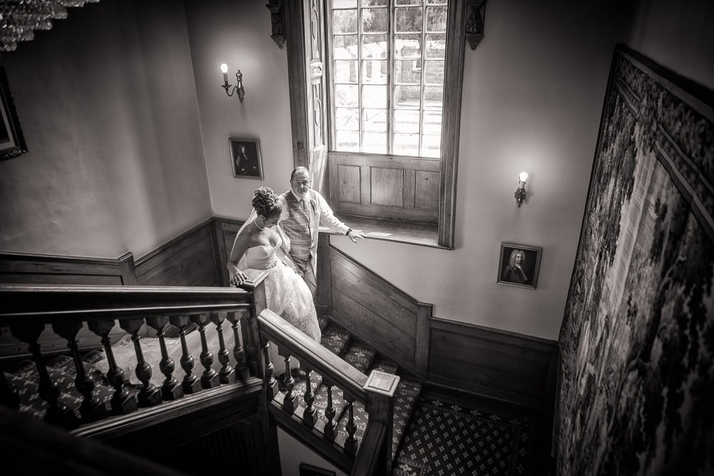 Bride and Father walking down stairs at Hockwold Hall Wedding