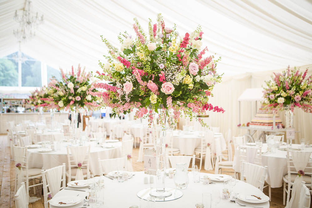 Beautiful flower centre pieces in a wedding marquee