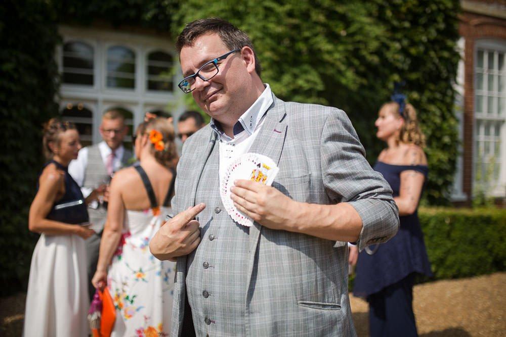 close up of Wayne goodman wedding magician at a wedding displaying a fan of playing cards