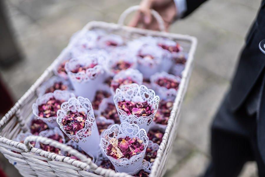 Tray holding lots of natural confetti presented at this Lanwades Hall Wedding