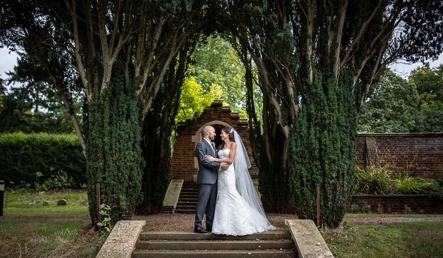 Bride and groom embracing at a Lanwades Hall Wedding