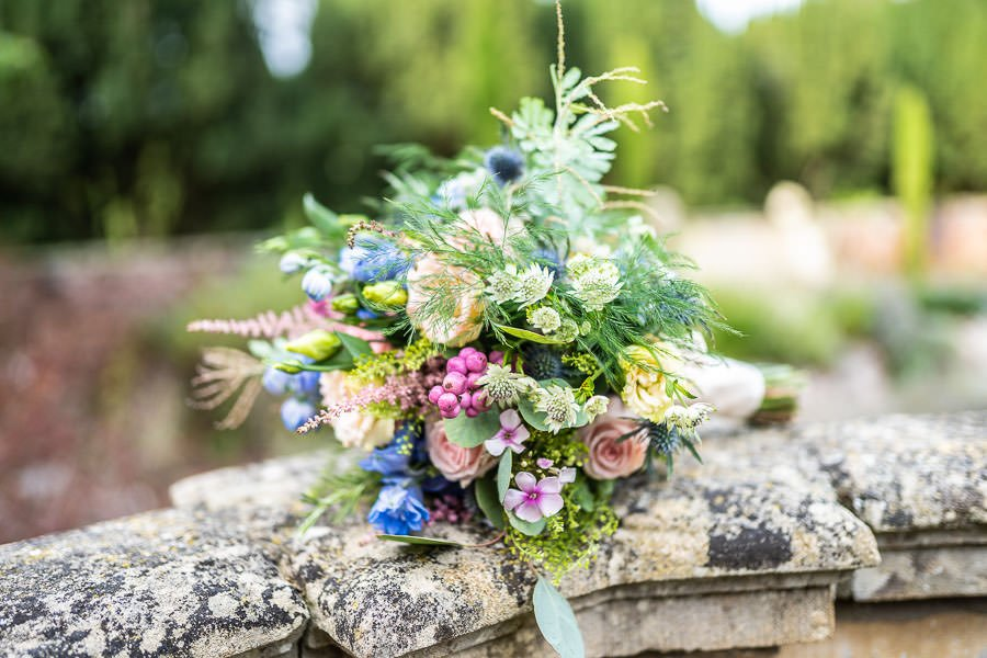 floral bouquet on a wall as featured at this Lanwades Hall Wedding