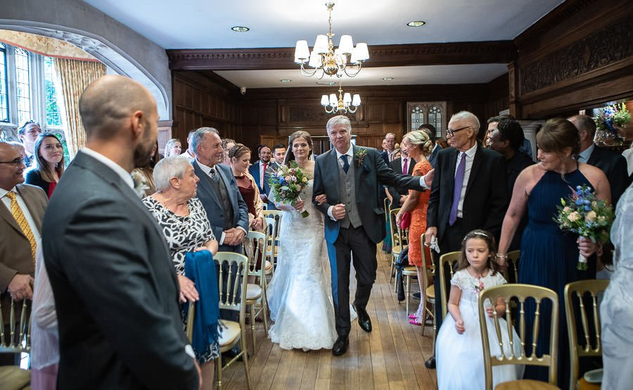 Bride and Father walking down the isle at Lanwades Hall Wedding