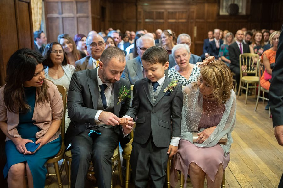 Paige Boy being given the rings at Lanwades Hall Wedding